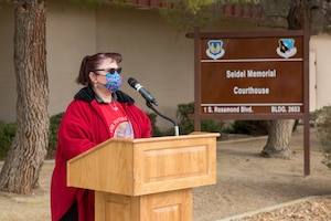 "Courtesy Photo | Nadine Seidel, wife of the late Warren Seidel, gives remarks at the renaming ceremony of the ""Seidel Memorial Courthouse"" at Edwards Air Force Base, California, March 18. The courthouse is named after her husband, Warren Seidel, who passed away last year following a short battle with cancer, he had served at Edwards for almost 25 years. (Air Force photo by Richard Gonzales"