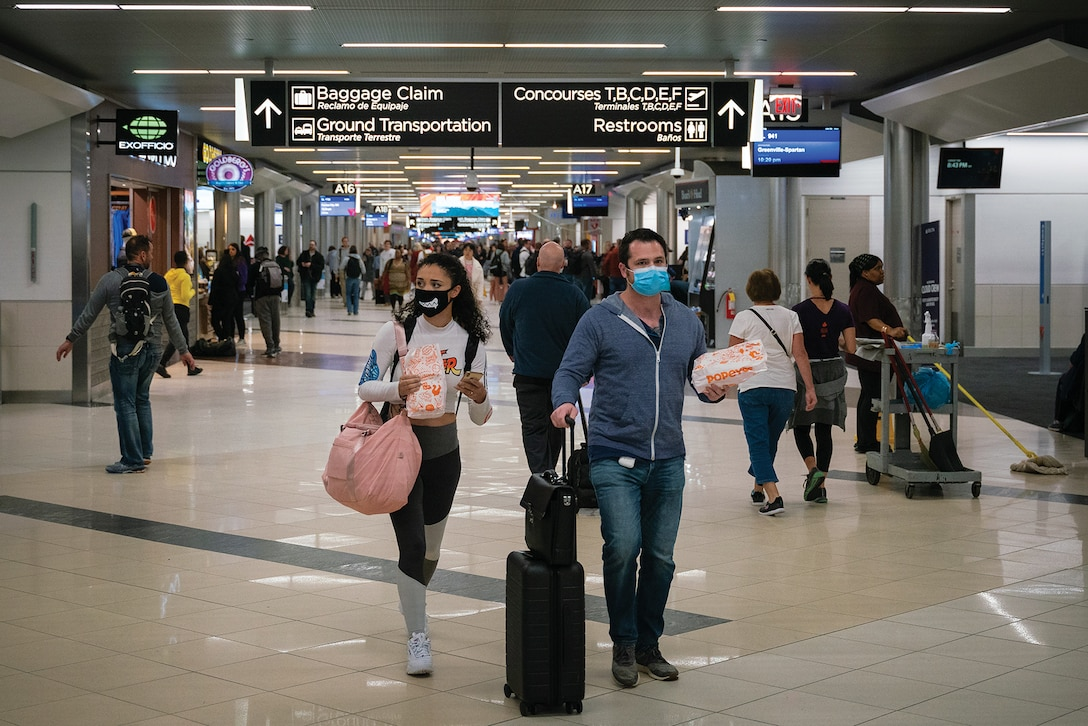 Flyers at Hartsfield-Jackson Atlanta International Airport wearing facemasks on March 6th, 2020 as the COVID-19 coronavirus spreads throughout the United States. (Chad Davis, March 6, 2020)