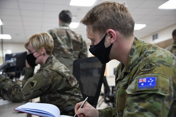 Australian Army Capt. Dustin Gold, a reserve officer from the Royal Australian Artillery's 9th Regiment, is participating in a Reserve Forces Foreign Exchange Program with the D.C. National Guard in Washington D.C., Jan. 23, 2021. A reciprocal arrangement between the United States, Australia, Canada and the United Kingdom enables reservists and guardsmen to continue their service while living abroad. The program is a coordinated international exchange between reserve NATO forces to help cultivate intercultural competence, regional expertise and interoperability. (U.S. Air National Guard photo by Senior Airman Amanda Bodony)