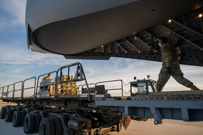 Cargo specialists from the 436th Aerial Port Squadron prepare to load cargo onto a Royal Australian Air Force C-17 Globemaster III at Dover Air Force Base, Delaware, March 13, 2021. The U.S. and Australia maintain a robust relationship underpinned by shared democratic values, common interests and cultural bonds. The U.S.–Australia alliance is an anchor for peace and stability in the Indo-Pacific region and around the world.
