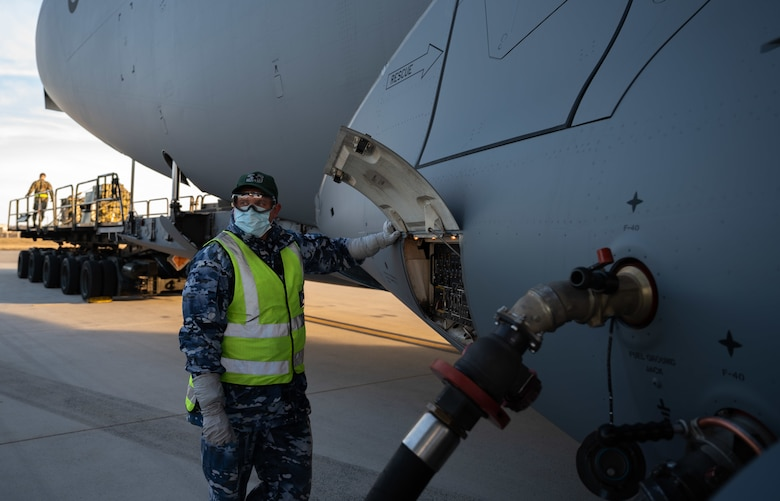 Sgt. Symon Brady, Royal Australian Air Force 36th Squadron aeronautical life support fitter, oversees fueling of a RAAF C-17 Globemaster III at Dover Air Force Base, Delaware, March 13, 2021. The U.S. and Australia maintain a robust relationship underpinned by shared democratic values, common interests and cultural bonds. The U.S.-Australia alliance is an anchor for peace and stability in the Indo-Pacific region and around the world. (U.S. Air Force photo by Airman 1st Class Faith Schaefer)