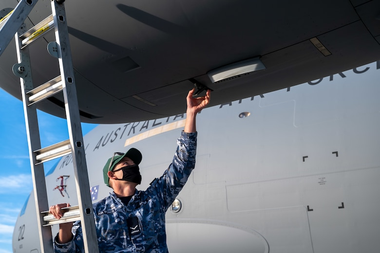 Leading Aircraftman Damian Babir, Royal Australian Air Force 36th Squadron aircraft technician, unlatches the engine accessory doors of a RAAF C-17 Globemaster III at Dover Air Force Base, Delaware, March 13, 2021. The U.S. and Australia maintain a robust relationship underpinned by shared democratic values, common interests and cultural bonds. The U.S.-Australia alliance is an anchor for peace and stability in the Indo-Pacific region and around the world. (U.S. Air Force photo by Airman 1st Class Faith Schaefer)