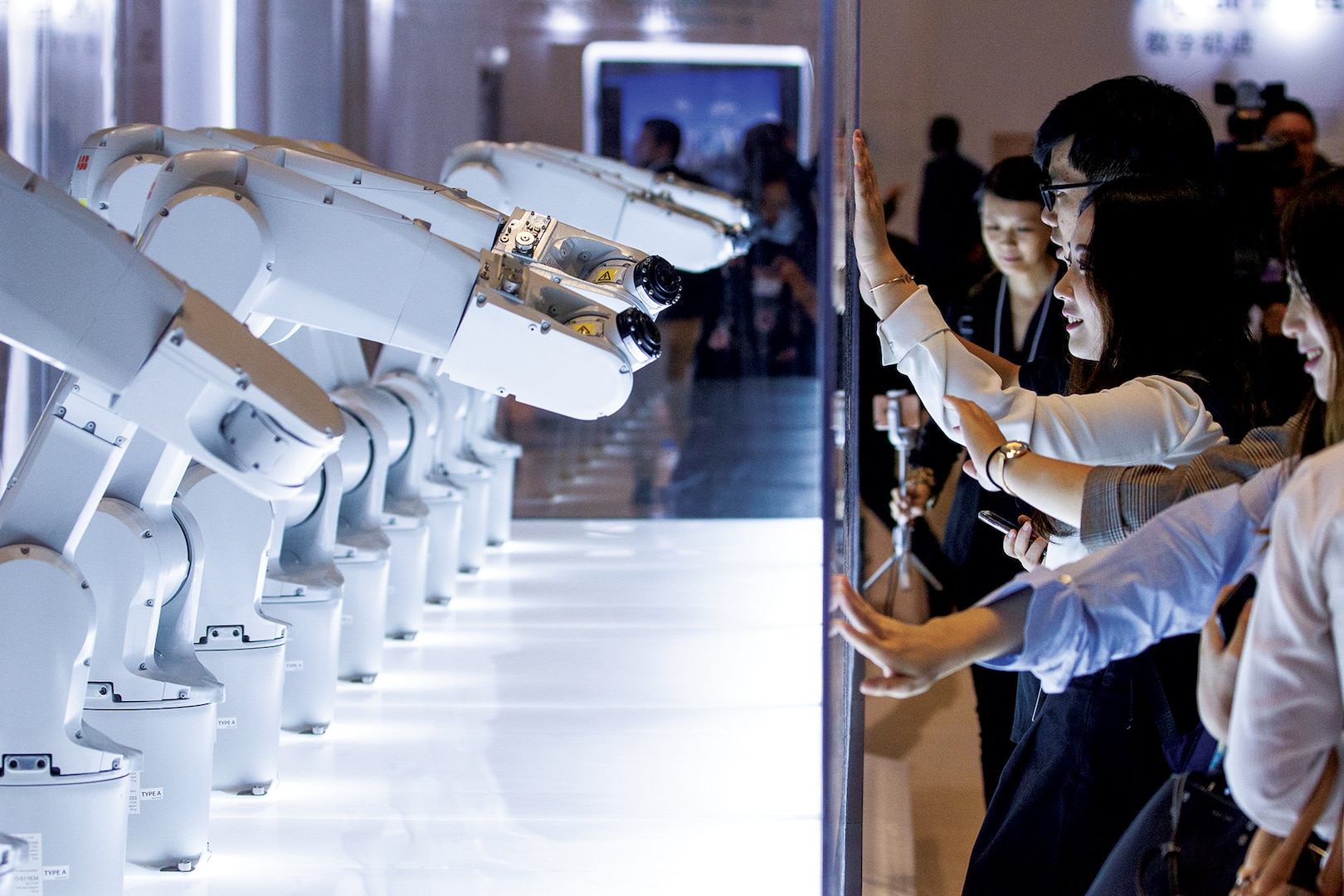"Participants interact with robots at the World Economic Forum - Annual Meeting of the New Champions in Tianjin, People's Republic of China 2018."" (World Economic Forum photo by Greg Beadle, September 18, 2018)"