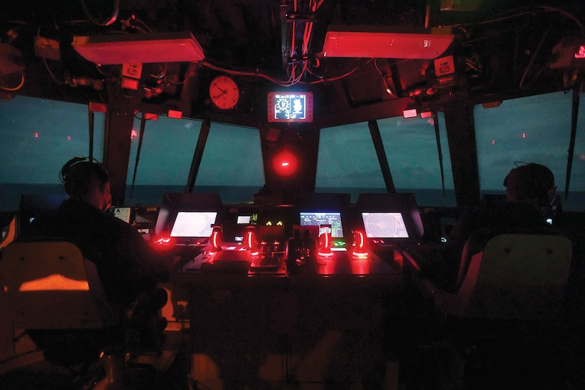 """Navy Lt. j.g. Justin Bishop and Chief Petty Officer David Thompson keep watch in the navigation bridge aboard the USS Sioux City in the Caribbean Sea."""" December 21, 2020 (Photo by Navy Seaman Juel Foster, Nov. 23, 2020)"""