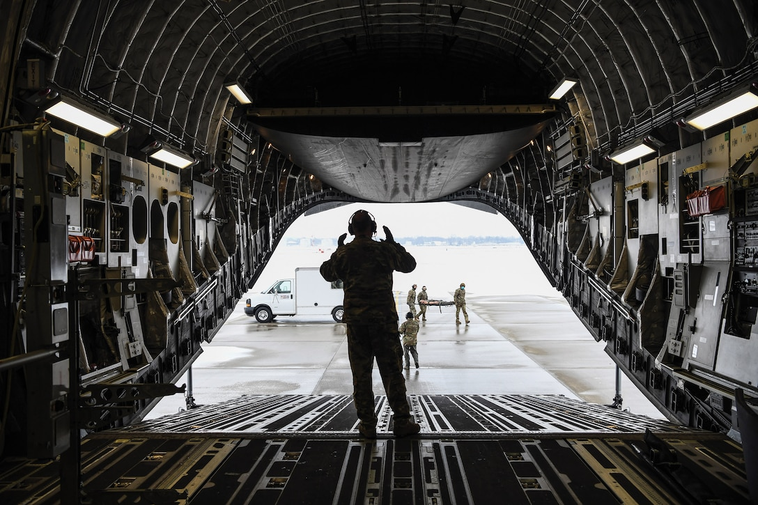 Members of the 445th Aeromedical Evacuation Squadron load a 445th Airlift Wing C-17 Globemaster III with medical equipment during a local mission training sortie, Feb. 11, 2021. The cargo area of the C-17 can hold 36 litters and 54 ambulatory patients and attendants with a basic crew of five, two flight nurses and three medical technicians for aeromedical evacuations.
