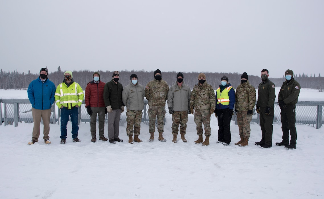 Maj. Gen. William Graham, deputy commanding general of civil and emergency operations for the U.S. Army Corps of Engineers (sixth from left), stands on the control works of the Moose Creek Dam with representatives of the Chena River Lakes Flood Control project on Feb. 19 near North Pole.