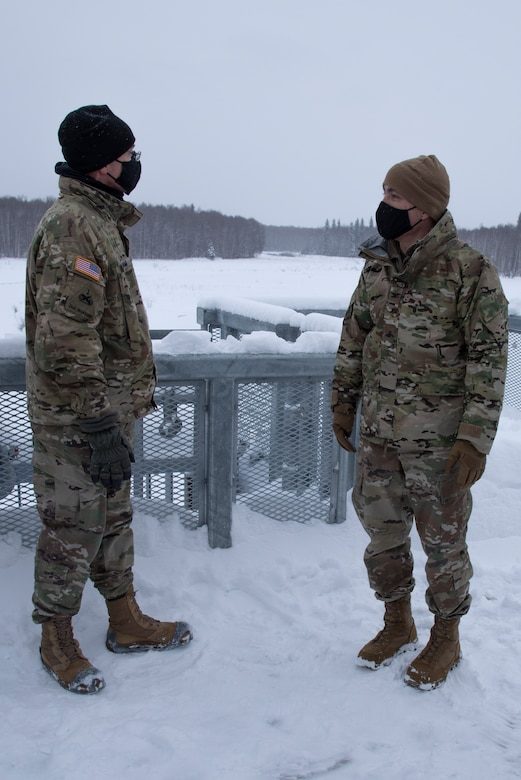 Maj. Gen. William Graham, deputy commanding general of civil and emergency operations for the U.S. Army Corps of Engineers, discusses the Chena River Lakes Flood Control Project with Col. Damon Delarosa, USACE Alaska District commander, on top of the Moose Creek Dam control works on Feb. 19 in North Pole.