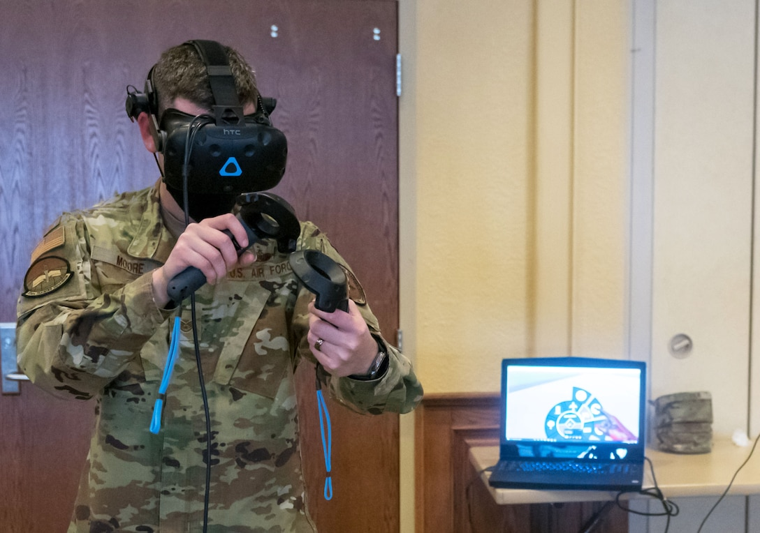 U.S. Air Force Staff Sgt. Braden Moore, 334th Training Squadron instructor, tests the airfield management virtual reality trainer during the 81st Training Group Next Level Showcase inside the Bay Breeze Event Center at Keesler Air Force Base, Mississippi, March 17, 2021. The showcase was the crowning point of the 81st TRG's past year technological and innovative think tank. (U.S. Air Force photo by Andre' Askew)