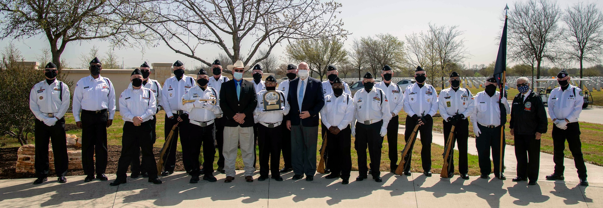 Members of the Fort Sam Houston Memorial Services Detachment, along with Robert C. (Bob) Winkler and Graham L. Wright III, assistant directors of the U.S. Department of Veterans Affairs National Cemetery Administration Fort Sam Houston National Cemetery, pose for a photo at the Fort Sam Houston National Cemetery in San Antonio March 15. A ceremony was held to commemorate the detachment's 40,000th funeral service.