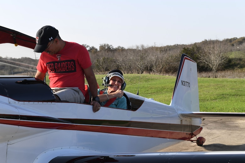 Maj. Cindy Piccirillo, 149th Fighter Wing director of inspections, prepares for her flight over Bulverde, Texas, March 15, 2021, during a ride with Col. Raul Rosario, 149th FW commander, in an RV-4 airplane.