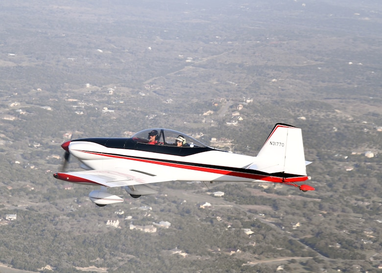 Maj. Cindy Piccirillo, 149th Fighter Wing director of inspections, flies over Bulverde, Texas, March 15, 2021, during a ride with Col. Raul Rosario, 149th FW commander, in an RV-4 airplane.