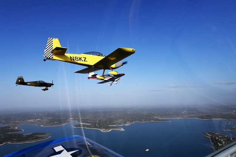 Maj. Cindy Piccirillo, 149th Fighter Wing director of inspections, flies over Bulverde, Texas, March 15, 2021, during a ride with Col. Raul Rosario, 149th FW commander, in an RV-4 airplane alongside similar aircraft.