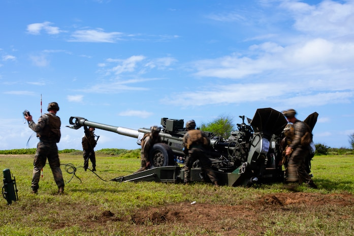U.S. Marines with Alpha Battery, 1st Battalion, 12th Marines, set up an M777A2 Howitzer during exercise Spartan Fury 21.1, Pacific Missile Range Facility, Kauai, Hawaii, March 10, 2021. Exercise Spartan Fury demonstrates 1/12's ability to conduct distributed operations inside an adversary's sensors and weapons engagement zone, attain and defend key maritime terrain, and conduct sea denial in support of fleet operations. (U.S. Marine Corps photo by Lance Cpl. Brandon Aultman)