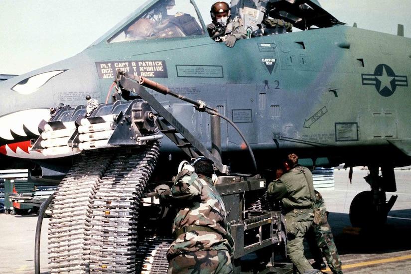 Troops work on a jet.