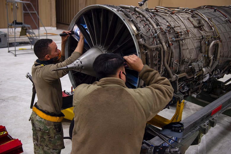 Staff Sgt. Jeremy Ward, left, 314th Aircraft Maintenance Unit assistant dedicated crew chief, and Staff Sgt. Aharon Garcia, 314th AMU Aerospace Propulsion craftsman, repair blade damage on an F-16 Viper engine, March 5, 2021, on Holloman Air Force Base, New Mexico. Ward and Garcia helped switch out a serviceable engine from one F-16 to another in preparation for the temporary duty assignment to Tyndall AFB, Florida for the Weapons System Evaluation Program. (U.S. Air Force photo by Airman 1st Class Quion Lowe)