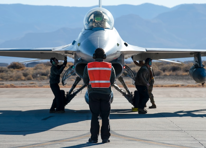 Airmen from the 314th Aircraft Maintenance Unit perform an end of runway inspection on an F-16 Viper, March 5, 2021, on Holloman Air Force Base, New Mexico. The Airmen were preparing for a temporary duty assignment for the Weapons Systems Evaluation Program at Tyndall AFB, Florida, where they worked in a joint environment to evaluate air-to-air weapons systems on behalf of Air Combat Command. (U.S. Air Force photo by Airman 1st Class Quion Lowe)