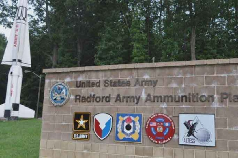 """A sign made of brick reads """"United States Army - Radford Army Ammunition Plant."""""""