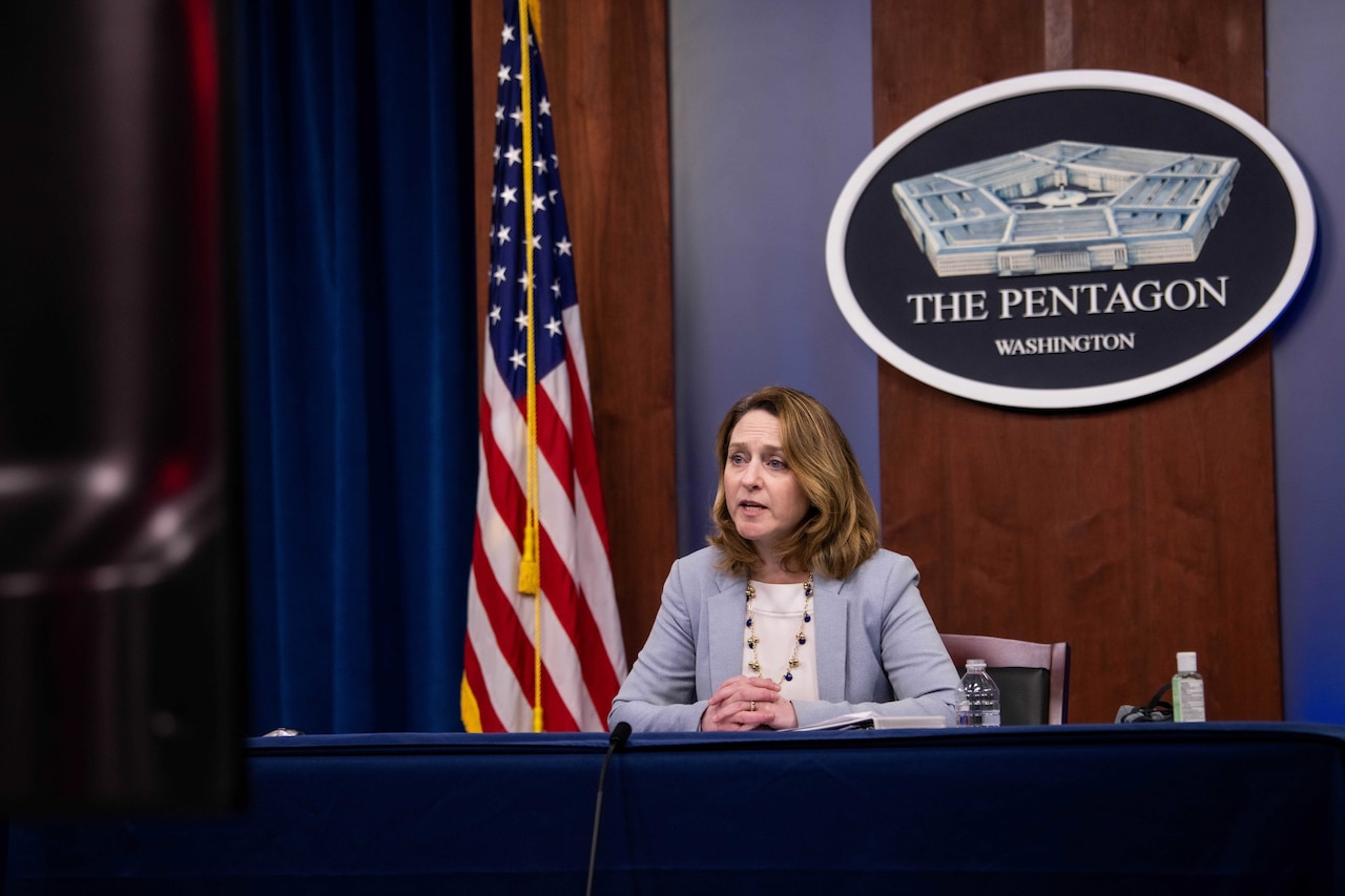 Deputy Defense Secretary Kathleen H. Hicks sits and speaks at a table.