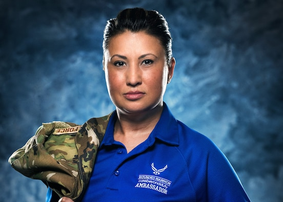 Master Sgt. Bronwen Gulledge, 26th Space Aggressor Squadron, Adversary Intelligence Flight, flight superintendent, poses in her Air Force Wounded Warrior Program ambassador shirt, Feb. 19, at  Schriever Air Force Base, Colorado.