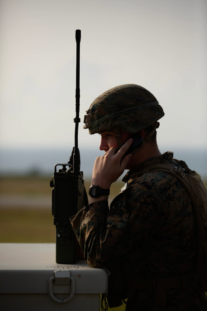 A U.S. Marine with 3d Battalion, 8th Marine Regiment, participates in an air assault during Castaway 21.12 at Ie Shima, Okinawa, Japan, March 11, 2021. The exercise demonstrated the Marine Corps' ability to integrate with the joint force to seize and defend key maritime terrain, provide low-signature sustainment, and execute long-range precision fires in support of naval operations from an expeditionary advanced base. 3/8 is currently attached to 3d Marine Division under the Unit Deployment Program.