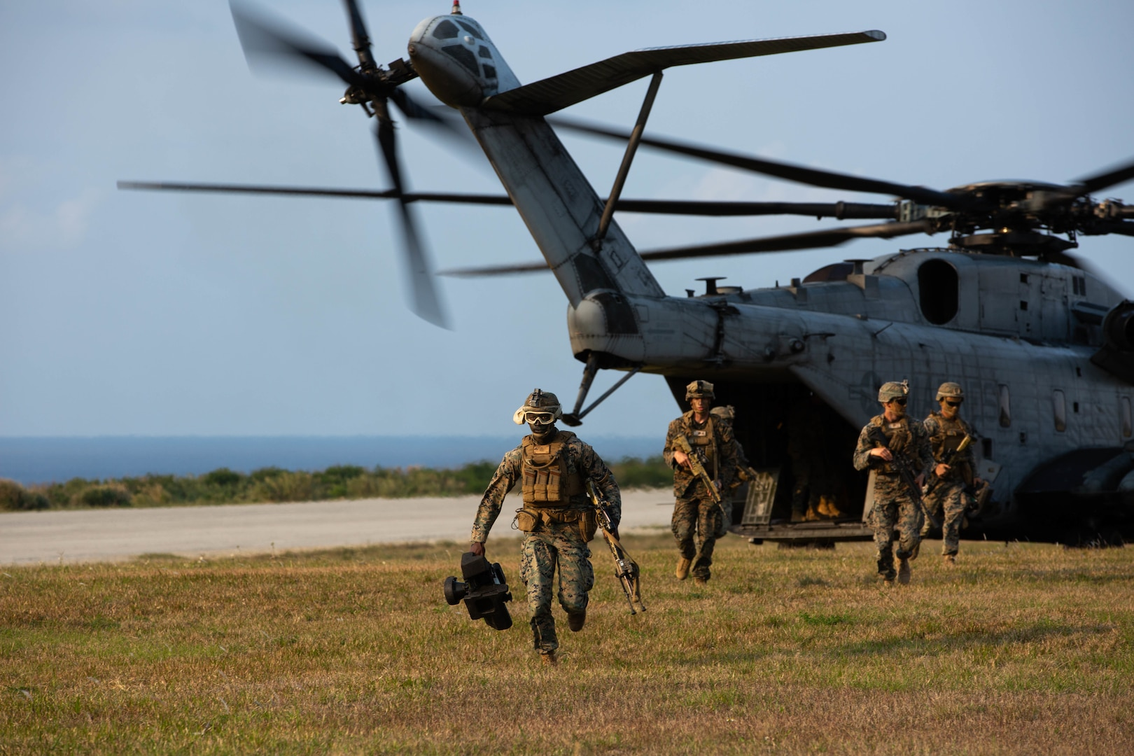 U.S. Marines with 3d Battalion, 8th Marine Regiment, exit a CH-53E Super Stallion during Castaway 21.1 to conduct an air assault on Ie Shima, Okinawa, Japan March 11, 2021. The exercise demonstrated the Marine Corps' ability to integrate with the joint force to seize and defend key maritime terrain, provide low-signature sustainment, and execute long-range precision fires in support of naval operations from an expeditionary advanced base. 3/8 is currently attached to 3d Marine Division under the Unit Deployment Program.