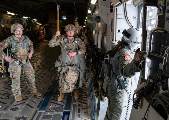 Women assigned to the 82nd Airborne Division, Pope Army Airfield, N.C., and 437th Airlift Wing, Joint Base Charleston, S.C., participated in an all-female flight in commemoration of Women's History Month, March 17, 2021. The flight included 80 female paratroopers who boarded two C-17s with all-female crews to perform a jump. Due to weather constraints, the paratroopers were unable to complete their jump. (U.S. Air Force photo by Staff Sgt. Rachel Pye)