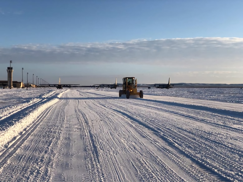 Airmen with the 7th Bomb Wing use snowplows to clear out the snow at Dyess Air Force Base, Texas, February 19th 2021.