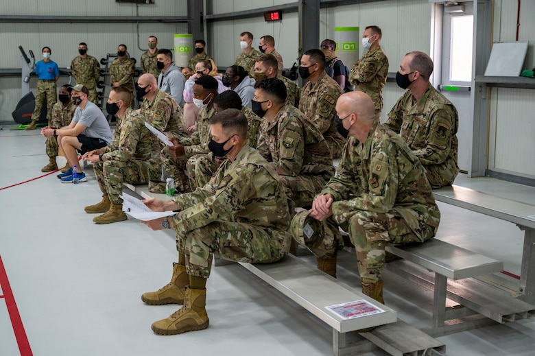 Members of the 380th Air Expeditionary Wing (AEW) receive a COVID-19 vaccine