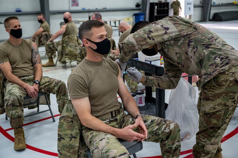 Brig. Gen. Larry Broadwell receives a COVID-19 vaccination