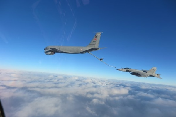 The Turkish Air Force and aircraft assigned to Carrier Air Wing (CVW) 3 conduct a mid-air fueling over the Black Sea.
