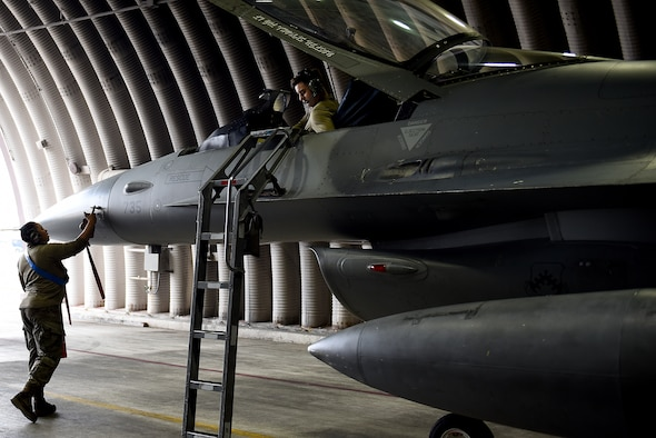 Senior Airman Marirosa Padilla-Tung, 8th Aircraft Maintenance Squadron crew chief, and Staff Sgt. Ashley Mounts, 8th AMXS dedicated crew chief, perform a post-flight inspection on an F-16 Fighting Falcon at Kunsan Air Base, Republic of Korea, March 21, 2021. Crew chiefs inspect, service, clean, and fix aircraft to ensure mission readiness. (U.S. Air Force photo by Senior Airman Suzie Plotnikov)