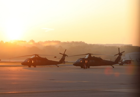 Two D.C. National Guard UH-60 Blackhawk helicopters sit on the tarmac at Davidson Army Airfield prior to an aeromedical support mission 25 April 2020. (US Army Photo by SSG Andrew Enriquez, DC National Guard 715th Public Affairs Detachment)