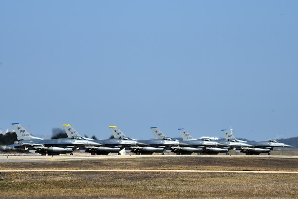 """F-16 Fighting Falcons from the 35th Fighter Squadron """"Pantons"""" and 80th Fighter Squadron """"Juvats"""" park on the flightline at Kunsan Air Base, Republic of Korea, March 22, 2021. The F-16 Fighting Falcon is a compact, multi-role fighter aircraft that is highly maneuverable in air-to-air combat and air-to-surface attack. (U.S. Air Force photo by Senior Airman Suzie Plotnikov)"""