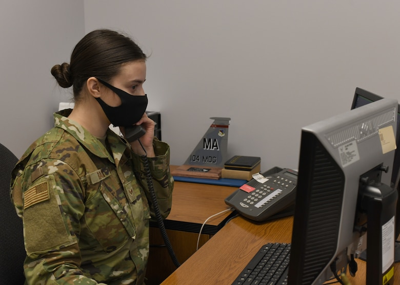 Senior Airman Weronika Baczek, public health technician, 104th Medical Group, answers calls pertaining to possible contact with COVID-19, in her office at Barnes Air National Guard Base, Massachusetts, Feb. 17, 2021. Contact tracing is critical for safeguarding 104th Fighter Wing mission readiness and the health of our Barnestormers and surrounding communities from COVID-19. (U.S. Air National Guard courtesy photo)