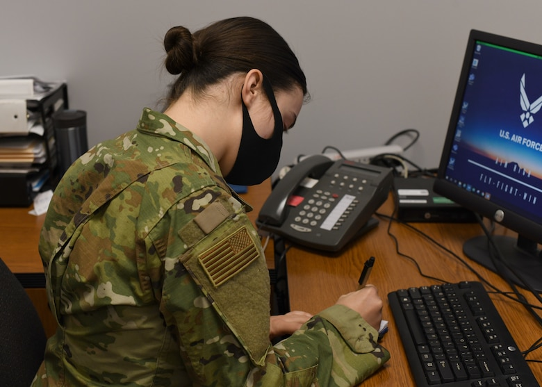 Senior Airman Weronika Baczek, public health technician, 104th Medical Group, takes down notes about a patient, in her office at Barnes Air National Guard Base, Massachusetts, Feb. 17, 2021. Contact tracing is critical for safeguarding 104th Fighter Wing mission readiness and the health of our Barnestormers and surrounding communities from COVID-19. (U.S. Air National Guard courtesy photo)