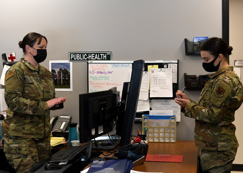 Senior Airman Weronika Baczek, public health technician, 104th Medical Group, discusses updates on the contact tracing program with Master Sgt. Christine Lupacchino, public health flight chief, 104MDG, in Lupacchino's office at Barnes Air National Guard Base, Massachusetts, Feb. 17, 2021. Contact tracing is critical for safeguarding 104th Fighter Wing mission readiness and the health of our Barnestormers and surrounding communities from COVID-19. (U.S. Air National Guard courtesy photo)