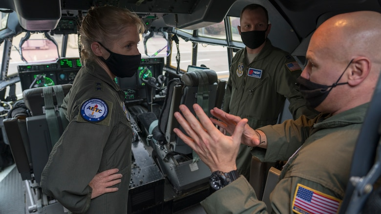 """Maj. Gen. Jeannie M. Levitt, director of operations and communications for the Air and Education Training Command at Joint Base San Antonio-Randolph, Texas, learns about the 53rd Weather Reconnaissance Squadron """"Hurricane Hunters"""" from Capt. Peyton Eustis (center), pilot for the 53rd WRS, and Master Sgt. Ed Scherzer (right), loadmaster for the 53rd WRS, during a visit at Keesler Air Force Base, Miss., March 19, 2021. After joining the Air Force in 1992, Leavitt became the branch's first female fighter pilot in 1993. She visited the 81st Training Wing and the Air Force Reserve's 403rd Wing, and she spoke to members of Team Keesler during an event recognizing International Women's History Month. (U.S. Air Force photo by Staff Sgt. Kristen Pittman)"""