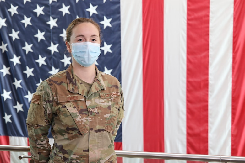 Airman 1st Class Hannah Jones-Trudeau poses for a photo Feb. 23, 2021, while working for Massachusetts National Guard's Joint Force Headquarters, at Hanscom Air Force Base, Massachusetts, and has been tasked with getting the COVID-19 vaccine to base. The COVID-19 vaccine is currently available to select Soldiers and Airmen based on risk and mission requirements but will be available widely as supplies increase. (U.S. Air National Guard photo by Capt. Aaron Smith)