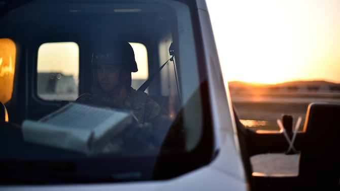 A maintainer waits to pick up Airmen during shift changeover.