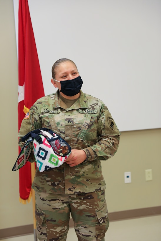 Sgt. Teresa Gonzalez, S1 NCOIC for the 1st Civil Affairs and Psychological Operations Training Brigade, thanks her colleagues and coworkers for their support of her after she was recognized by the Ft. Bragg USO as one of thirty female servicemembers across Ft. Bragg to be honored during Women's History month.