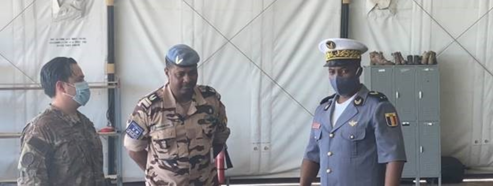 Brig. Gen. Idriss Amine Ahmed, Chadian Air Force chief of staff, right, and Lt. Col. Emmanuel Djangbei, Chadian Joint Intelligence, Surveillance and Reconnaissance Center director, center, congratulate U.S. Air Force Maj. John Harris, 818th Mobility Support Advisory Squadron assistant director of operations, left, on his final flight as a U.S. Air Force pilot March 8, 2021, at Adji Kossei Air Base, N'Djamena, Chad. Harris and air advisors from the 818th MSAS conducted training to accelerate Chadian Air Force peacekeeping and security operations in the region. (U.S. Army photo by Sgt. 1st Class Joshua Prestel)