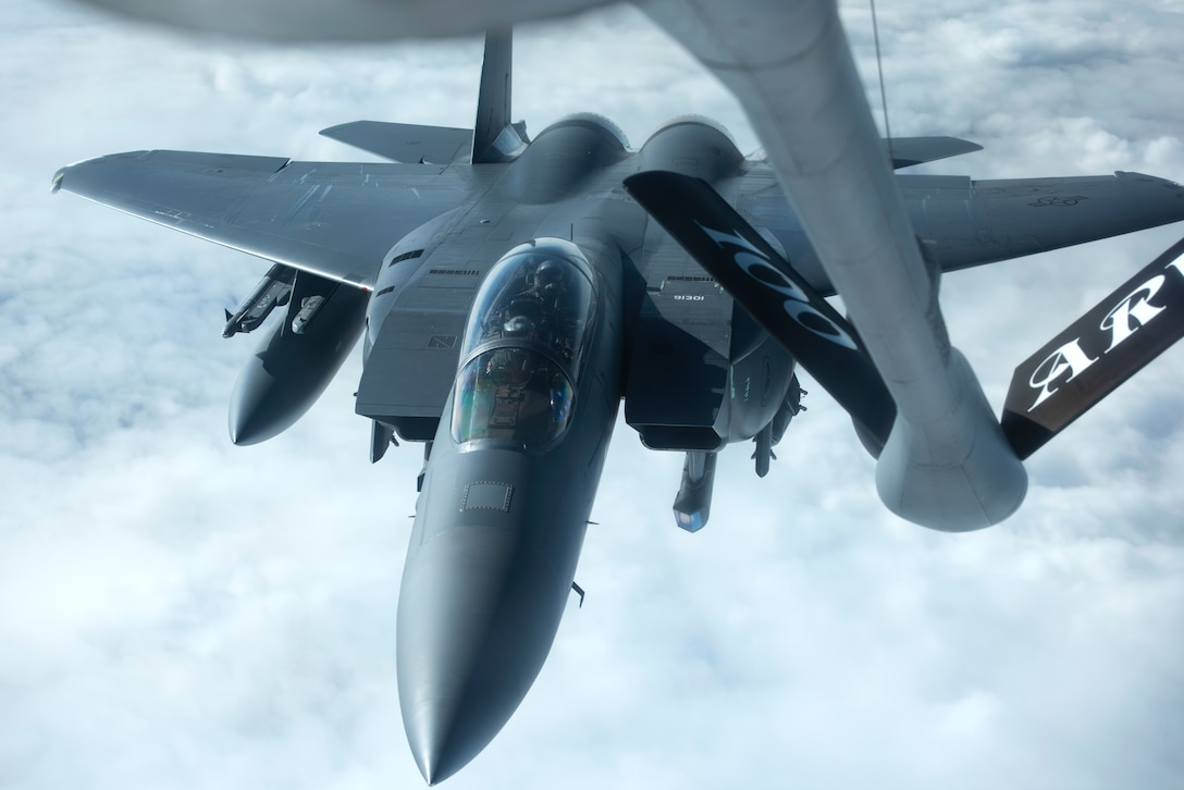 A 48th Fighter Wing F-15E Strike Eagle prepares to connect with a KC-135 Stratotanker for aerial refueling on the way to Amari Air Base, Estonia, in support of exercise Baltic Trident, March 15, 2021. Exercises like this strengthen interoperability with NATO allies and partner nations, and increase 48th FW sortie generation and sustainment capabilities away from home station through the application of Agile Combat Employment concepts. (U.S. Air Force photo by Airman 1st Class Jessi Monte)