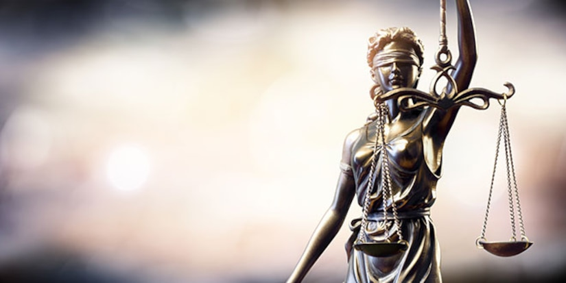 Statue of Lady Justice. Stock Photo © iStock.com/RomoloTavani