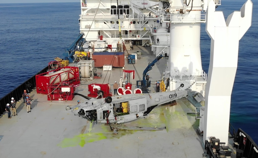 An MH-60S on deck of contracted salvage vessel off the coast of Yokosuka, Japan on March 18, 2021, having just been pulled from the depth of 19,075 ft by NAVSEA Supervisor of Salvage and Diving, (SUPSALV) at the request of the Navy Safety Center to facilitate accident investigation.