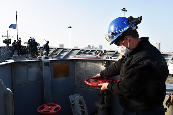 210321-N-IE405-1145 MANAMA, Bahrain (March 21, 2021) - Seaman Nikalus Wagley, assigned to guided-missile cruiser USS Philippine Sea (CG 58), checks the anchor chain brake during a sea and anchor detail prior to the ship departing from Manama, Bahrain, March 21. Philippine Sea is deployed to the U.S.  5th Fleet area of operations in support of naval operations to ensure maritime stability and security in the Central Region, connecting the Mediterranean and Pacific through the western Indian Ocean and three critical chokepoints to the free flow of global commerce. (U.S. Navy photo by Mass Communication Specialist 2nd Class Indra Beaufort/Release)