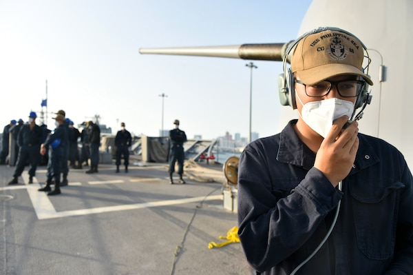 Seaman Dakota Golden, assigned to guided-missile cruiser USS Philippine Sea (CG 58), communicates with the bridge watch team during a sea and anchor detail prior to the ship departing from Manama, Bahrain, March 21. Philippine Sea is deployed to the U.S.  5th Fleet area of operations in support of naval operations to ensure maritime stability and security in the Central Region, connecting the Mediterranean and Pacific through the western Indian Ocean and three critical chokepoints to the free flow of global commerce.