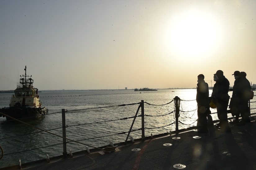 Sailors assigned to guided-missile cruiser USS Philippine Sea (CG 58) prepare to depart Manama, Bahrain, during a sea and anchor detail, March 21. Philippine Sea is deployed to the U.S.  5th Fleet area of operations in support of naval operations to ensure maritime stability and security in the Central Region, connecting the Mediterranean and Pacific through the western Indian Ocean and three critical chokepoints to the free flow of global commerce.