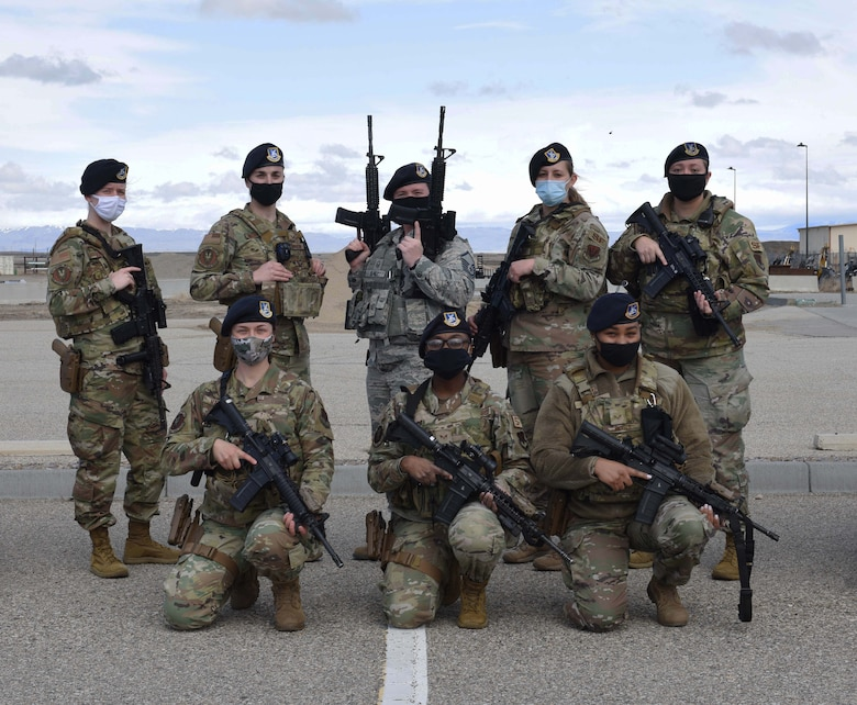 A group of female defenders from the 366th Security Forces Squadron pose for a photo, March 19, 2021, at Mountain Home Air Force Base, Idaho. In 1985, women were officially allowed to join in the security forces career field, meaning no job under that career field could be banned from them.