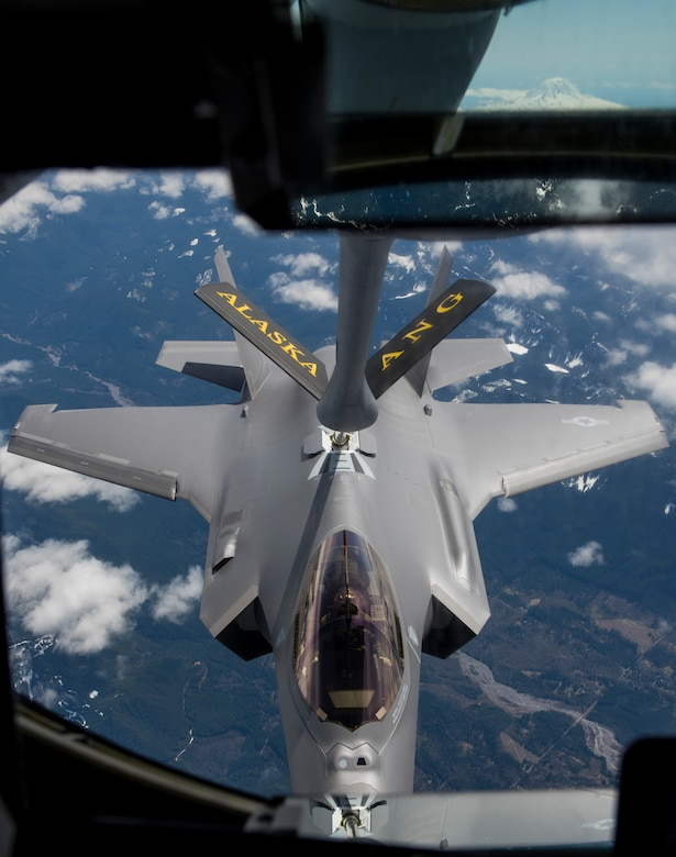 A new F-35A Lightning II refuels midair via a 168th Wing, Alaska Air National Guard KC-135R Stratrotanker, en route from the Lockheed Martin factory in Fort Worth, Texas, to the 354th Fighter Wing, Eielson Air Force Base, Alaska, April 21, 2020. The 168th will receive four more KC-135 Stratotankers and more than 200 active-duty U.S. Air Force personnel.