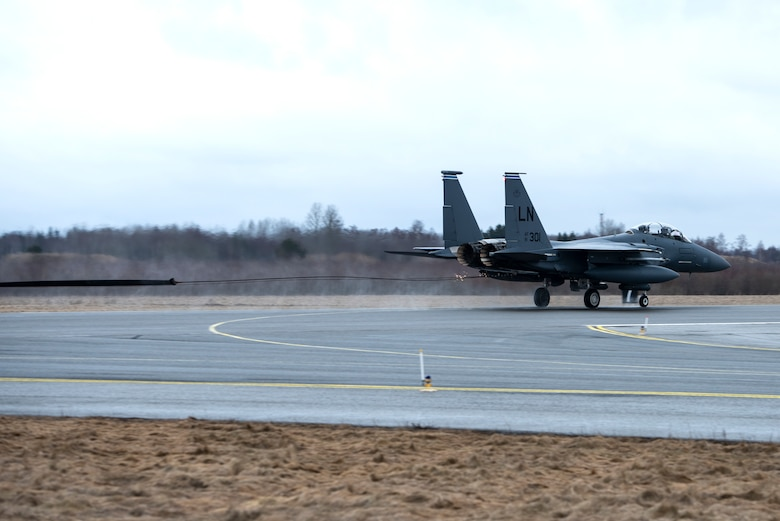 An F-15E Strike Eagle assigned to the 492nd Fighter Squadron catches the cable of an aircraft arresting system during a Barrier Arresting Kit certification at Ämari Air Base, Estonia, March 17, 2021. An aircraft arresting system is in place to bring aircraft to a safe stop in the event of an emergency that would prevent the aircraft from performing a standard landing. (U.S. Air Force photo by Airman 1st Class Jessi Monte)